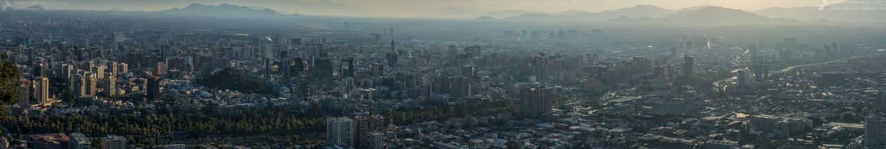 Yet another large panorama of downtown Santiago, a mix between corporative and residential buildings. Best seen fullsize.Downtown District DSLR Photography Aerial View Sky Skyscraper Telephoto Architecture Day Highrise Aerial Skyline Santiago De Chile Cityscape Sunset Pentaxero Dslrphotography Pentax K-3 PentaxianPanorama Urban Skyline Pentax Chile Cityscapes