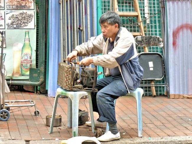 Street Life Adult Auto Repair Shop Day Full Length Hong Kong Human Body Part Indoors  Lifestyles Mature Adult Men Old-fashioned One Man Only One Mature Man Only One Person Only Men Owner People Repair Repair Job Repair Shop Repair Work Repairing Repairman Repairs Workshop