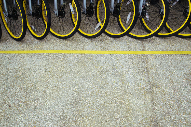 Bicycle alignment #yellow Bicycle Bicycle Rack Day Low Section No People Outdoors Transportation Paint The Town Yellow Fresh On Market 2017