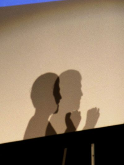 Anonymous Double Shadows Focus On Shadow Headshot Indoors  Shadow Shadow On The Wall Silhouette Speaker