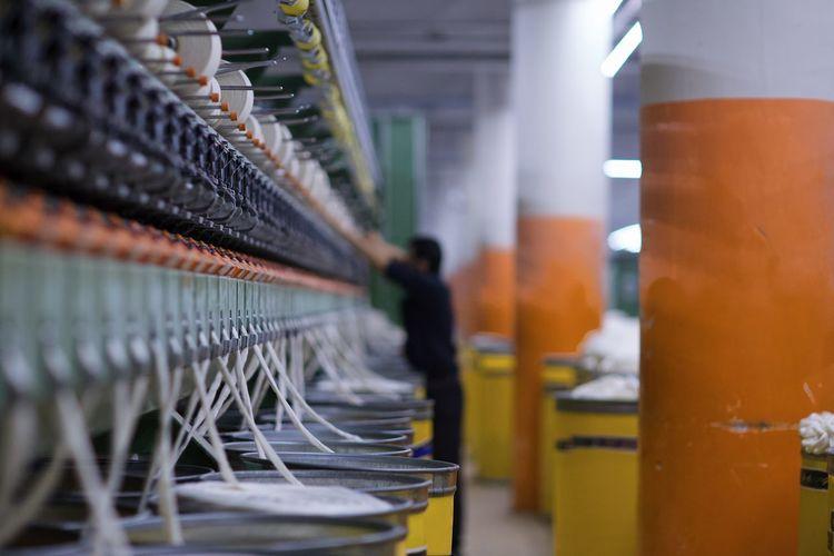 Row of illuminated machine in factory