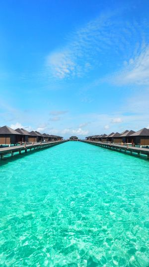 Water Blue Sea Travel Destinations Scenics Travel Vacations Outdoors Nature Landscape Beauty In Nature Refraction Mountain Clear Sky No People Sky Hot Spring