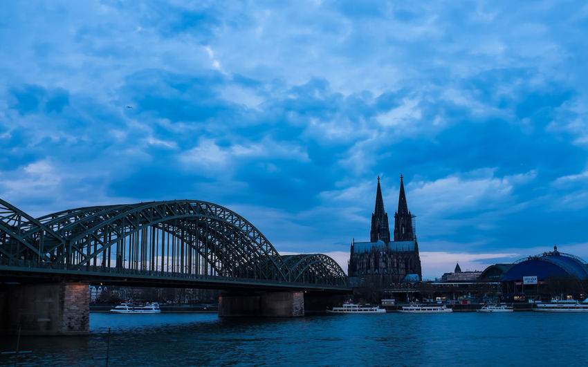 those rare days, when you get up and take pictures before the day really starts. Architecture Blue Hour Boats Bridge Bridge - Man Made Structure Cathedral Church City Cityscape Cologne Early Morning Hohenzollernbrücke Köln Kölner Dom No People Outdoors Rhein Rheinufer River Ships Sky Travel Travel Destinations Urban Skyline Water