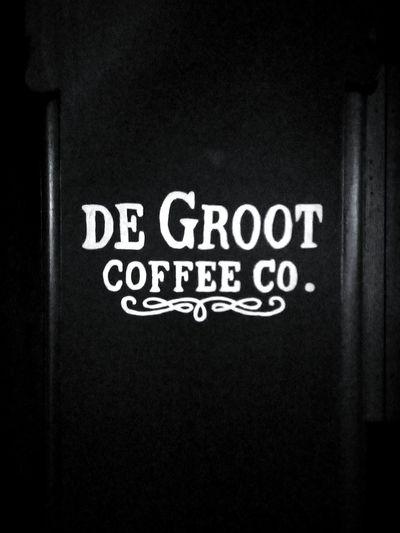 Capital Letter Coffee Shop Cafe Coffee Time CoffeeCompany Black & White No People Company Coffee Company DeGroot De Groot White Text Signboard Sign Hunters SignHunters Blackandwhite Black Background Black And White WhiteText CapitalLetters CAPITAL LETTERS. Commercial Signs Sign SIGN. Coffee Text Western Script Signboard Information