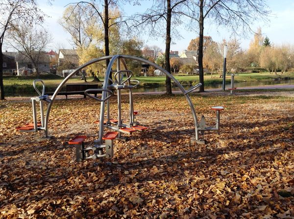 Autumn in Lithuania, 2015 Abandoned Absence Abundance Broken Change Damaged Day Full Length In A Row Leading Metal Narrow Outdoors Park Playground Railing Remote The Way Forward Wood Working