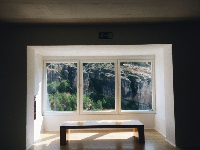 Table on floor by window of house