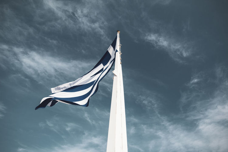 Acropolis Athens Greece Acropolis Cloud - Sky Sky Wind Patriotism Low Angle View Flag Environment Nature Waving No People Pole Day Outdoors Emotion Striped White Color Textile Motion Flying Independence Sailboat National Icon