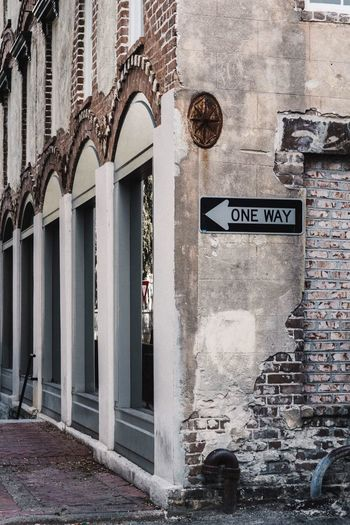 Streets of Savannah Text Architecture Built Structure Building Exterior Communication Western Script Day Building No People City Wall - Building Feature Outdoors Street Sign Script Non-western Script Entrance Door Old