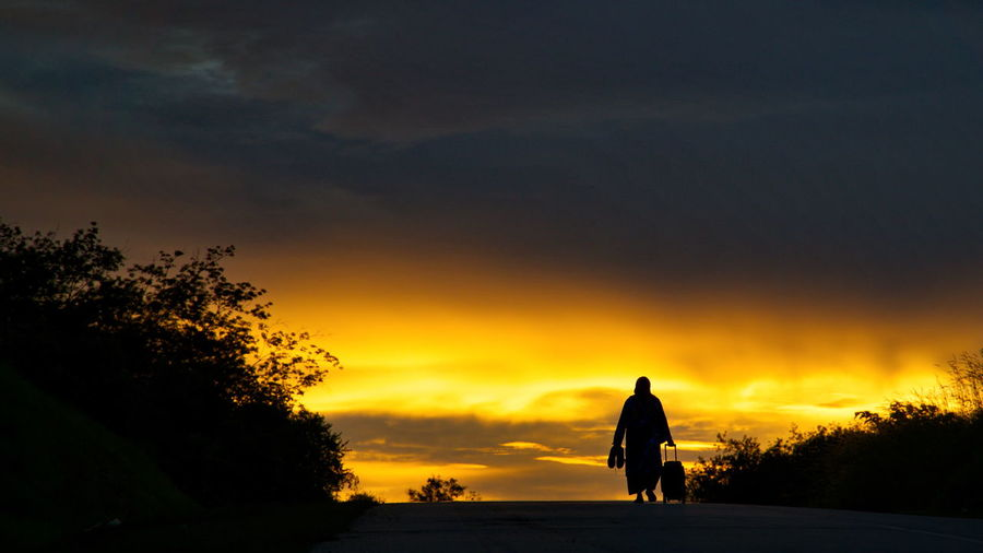 Walking Sunset Silhouette Beauty In Nature Nature Scenics Sky Landscape Outdoors Walking Alone... Walking Away Walking On Sunshine Walking On Sunset Walking Alone