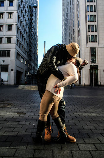 V-J Day Reloaded Berlin Broadway Eisenstaedt Kiss Adult Architecture Building Exterior Built Structure Casual Clothing City City Life Day Full Length Lifestyles Men Outdoors People Standing Street Two People Women Young Adult Young Women