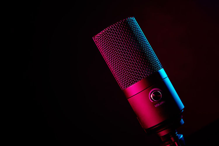 High angle view of illuminated lighting equipment against black background