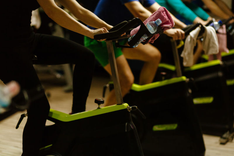 People using exercise bikes at gym