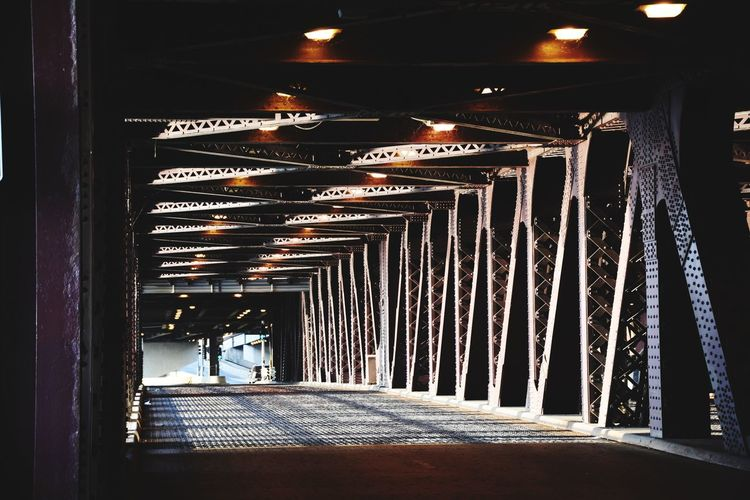 Man walking in illuminated corridor