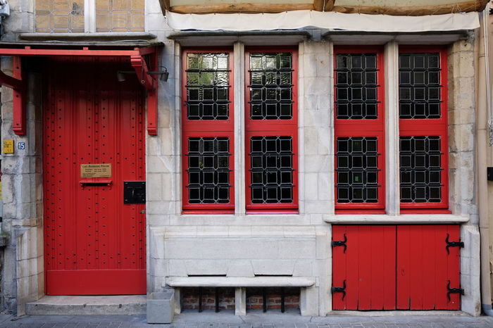 Facade of an old house in Antwerp Architecture Architecture Photography Building Exterior Built Structure City City Life Closed Closed Door Day Doorway Exterior Facade Building Front View House Middelage Old But Awesome Old Door Old House Outdoors Red Red Painted Wood Red Wood Red Wooden Door Restauration Window