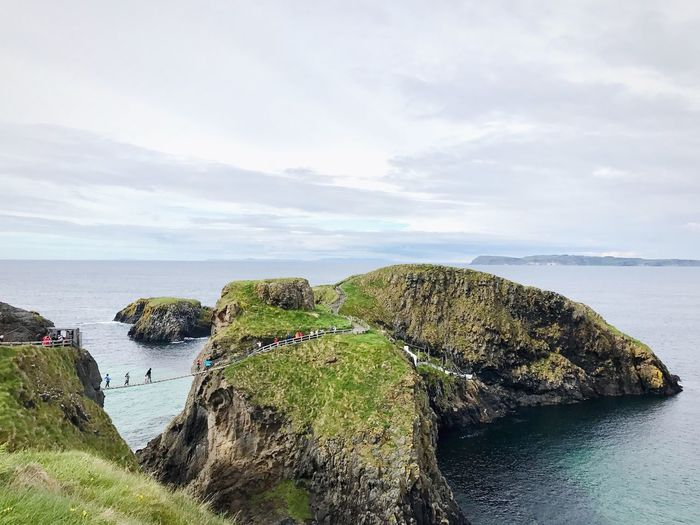 suspension bridge Suspension Bridge Travel Explore Irland Water Sea Sky Beauty In Nature Plant Scenics - Nature Nature Cloud - Sky Tranquility No People Tranquil Scene Growth Day Land Beach Horizon Over Water Green Color Rock Horizon Outdoors