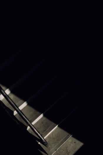 Concrete staircase in shadows.