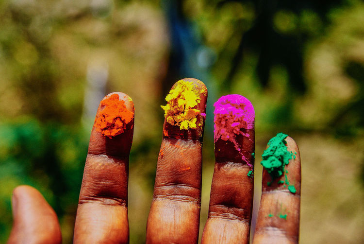 Close-up of hand with color powder