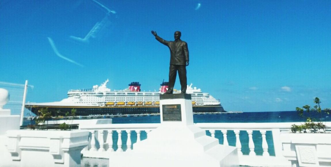 The mickey mous ship Mickey Mouse Ship Sky Travel Statue Sea Outdoors People Day Architecture Blue Cloud Streetphotography Beach Ocean Fun Sunny Day