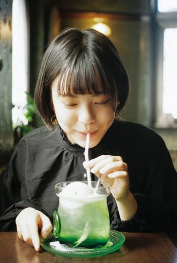 Portrait of cute boy drinking glass