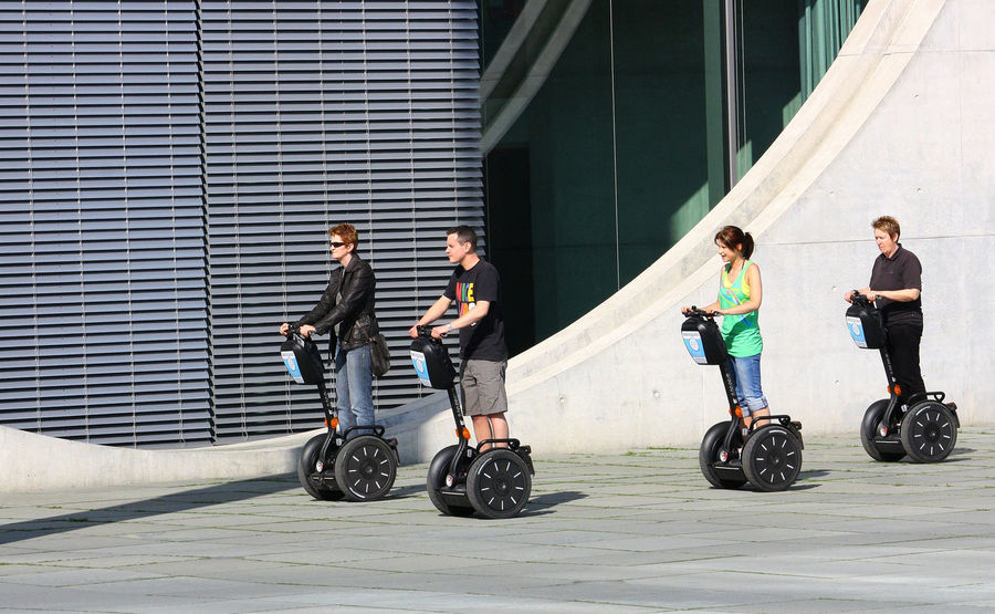 Tourists on a Segway tour in Berlin Berlin Germany Berlin By Segway No Helmet Alternative Means Of Transport Form Of Transport Giroscope Segway Ride Segways In Berlin Standing Upright Tour Berlin Two Wheels In Formation In Line Berlin Love