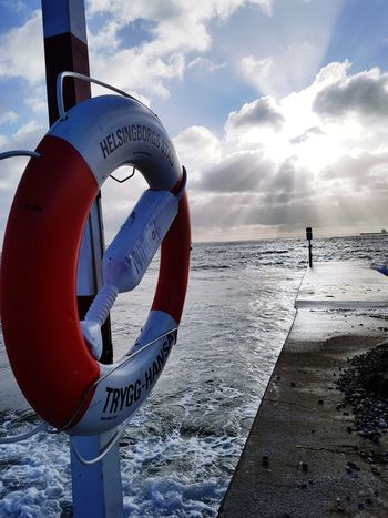 Beach Sea Safety Security Water Life Belt Cloud - Sky Protection Day Rescue Outdoors Sky Sunlight Horizon Over Water Full Length One Man Only Nature