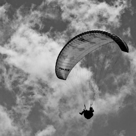 Extreme Sports Paragliding Parachute Gliding Mid-air Exhilaration Flying Adventure Silhouette Sports Helmet Freedom RISK Sky Pilot People One Person Headwear Stunt Person Cloud - Sky Excitement The Great Outdoors - 2017 EyeEm Awards