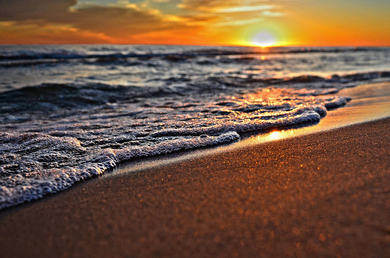 First Day of Summer Beach Beachphotography Beauty In Nature Greatlakes Lakemichigansunset Nature No People Outdoors Remote Scenics Shore Sky Sun Sunset Tranquil Scene Tranquility Water Wave