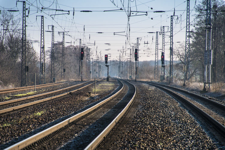 Brandenburg Winter Architecture Built Structure Cable Cold Temperature Day Electricity  Electricity Pylon No People Outdoors Power Line  Rail Transportation Railroad Track Railway Track Saarmund Sky The Way Forward Transportation An Eye For Travel Colour Your Horizn