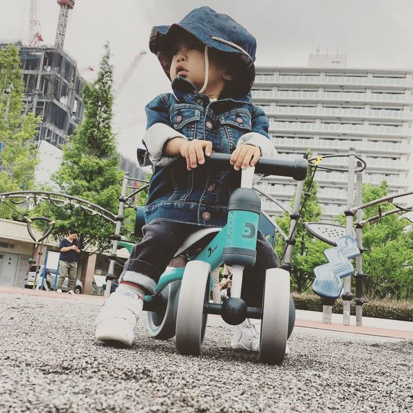 Son Trikerider Trikebike Childhood Child Leisure Activity Real People Lifestyles Full Length Boys One Person Casual Clothing Day Men Looking Away Front View Outdoors Innocence
