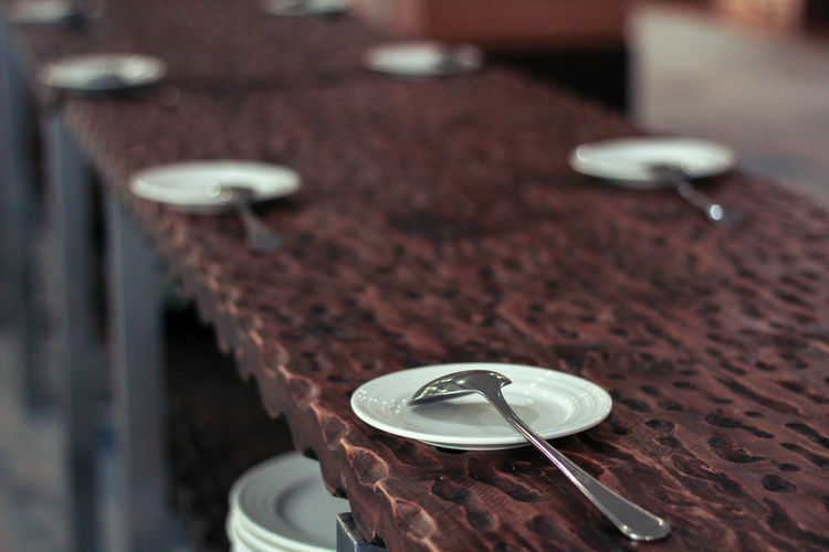 Spoons on plate at table