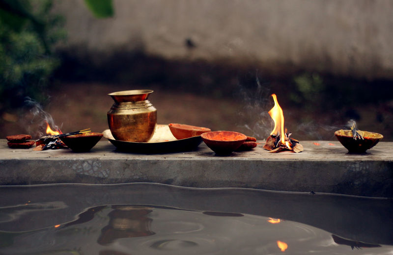 Flame And Containers By Water