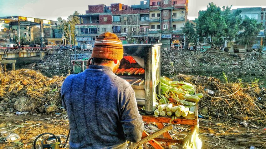 Real People Rear View Choice Variation One Person Outdoors Men Food Adult Day People Only Men Adapted To The City Oven Fire Corn EyeEmBestPics Week Of Eyeem Team EyeEm EyeEm Best Edits EyeEm Best Shots EyeEm Gallery EyeEm Background The City Light TCPM The Street Photographer - 2017 EyeEm Awards