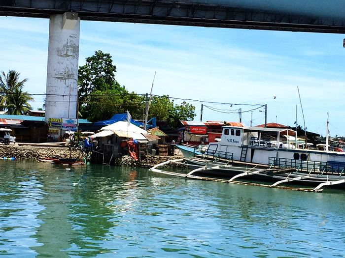 Life On The Edge Under The Bridge Boats And Water Cebu Philippines