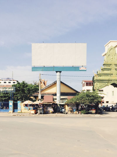 Busy Phnom Penh Advertising Architecture Billboard Building Building Exterior Built Structure Cambodia City City Life Day Empty Exterior Geometric No People Outdoors Sky Sunlight Sunny Urban