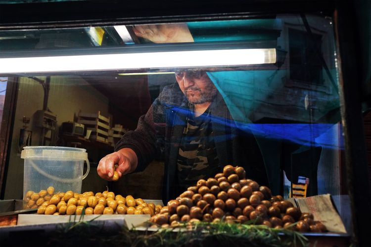 Man preparing food at market stall