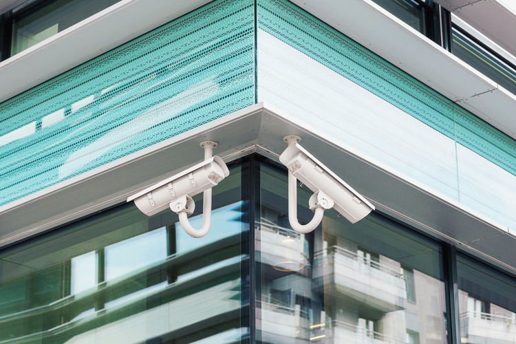 Cctv cameras on modern facade Video Camera Cctv Camera Surveillance Safety City Modern Window Architecture Close-up Building Exterior Built Structure Architectural Detail Architectural Feature Office Block Exterior Building