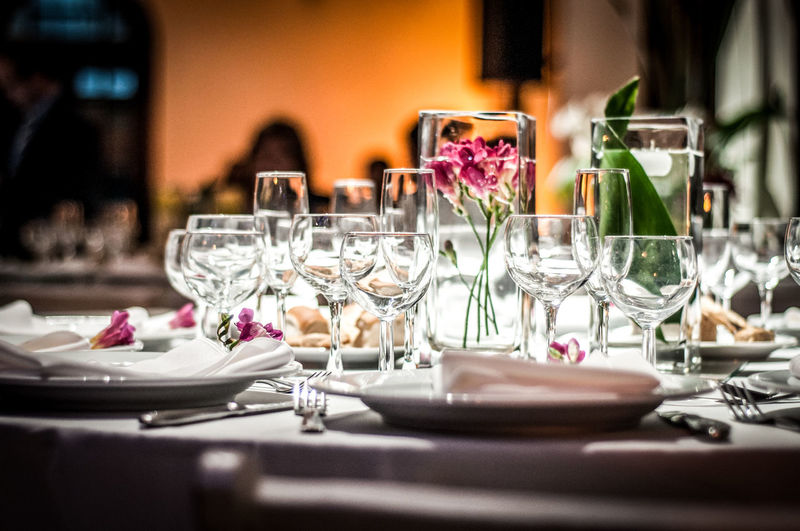 Dining table decoration. Arrangement Catering Service Close-up Decoration With Flowers Dining Dining Table Dinner Table Decoration Empty Focus On Foreground Freshness Night Night Lights No People Place Setting Restaurant Selective Focus Serving Size Still Life Table Table Arrangements Table Decoration Wedding Wedding Decoration