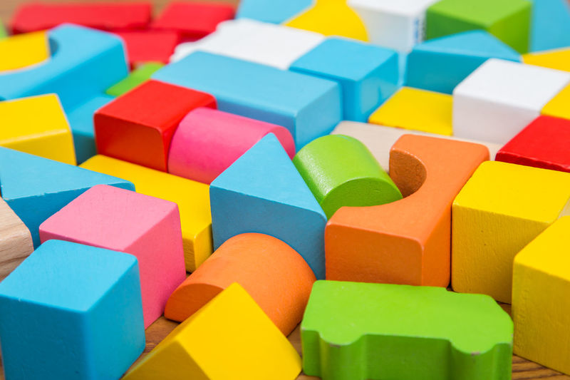 Architecture Backgrounds Block Block Shape Blue Close-up Cube Shape Day Large Group Of Objects Multi Colored No People Shape Toy Block Vibrant Color Yellow