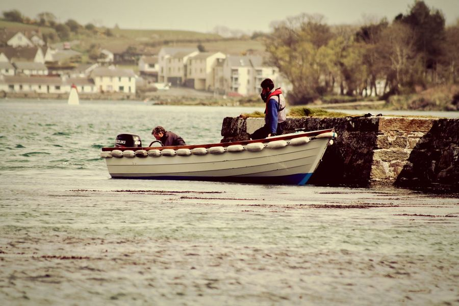 Two men loading a boat on Strangford Lough in Northern Ireland Boat Lake Strangford Strangford Lough Man On Boat