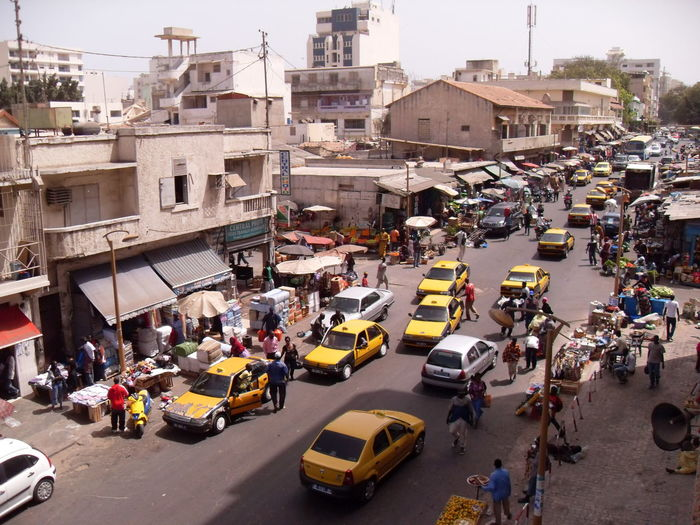 africa City Transportation Street Motor Vehicle Road Car Traffic City Life City Street Taxi Outdoors Busy Day Real People High Angle View Mode Of Transportation