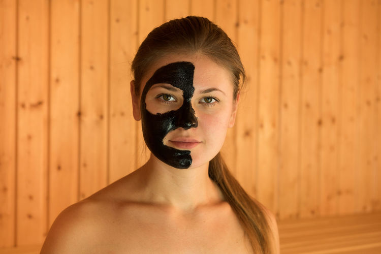 Portrait of beautiful woman with facial mask on face