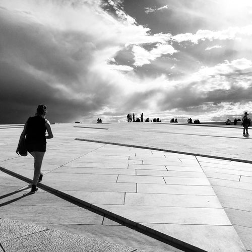 Rear View Of Woman Walking Towards People At Oslo Opera House