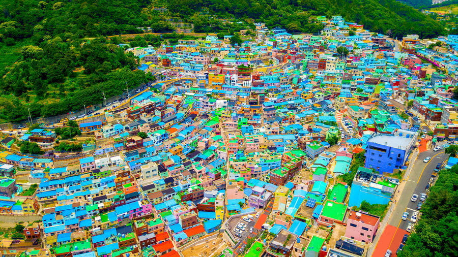 Gamcheon culture village in Busan, South Korea. Gamcheon Culture Village Abundance Aerial View Architecture Building Building Exterior Built Structure Busan Aerial View Celebration City Crowd Crowded Day Drone View Gamcheon Gamcheonculturevillage Growth High Angle View Multi Colored Nature Outdoors Plant Residential District Travel Destinations Tree
