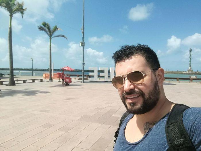 Man Wearing Sunglasses At Promenade Against Sky