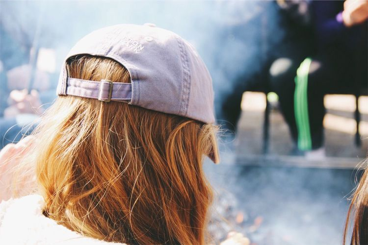 Rear View Of Woman Wearing Cap