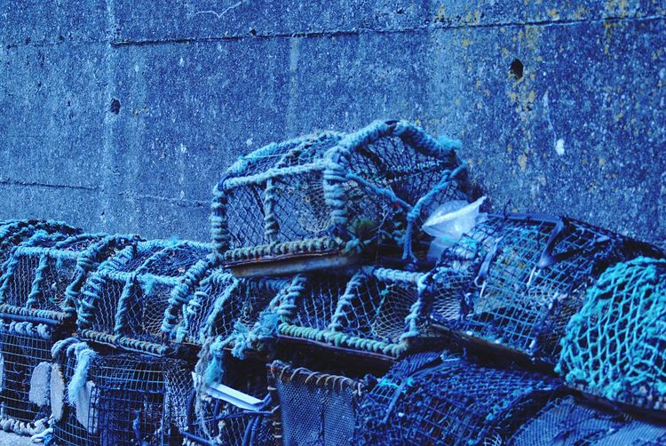 Lobster traps by wall