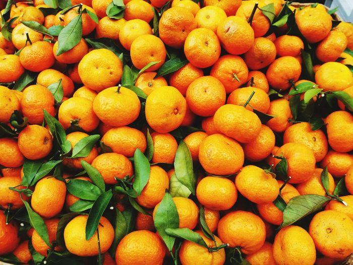 Full frame shot of oranges at market stall