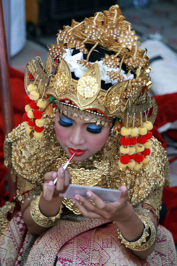 High Angle View Of Traditional Dancer Doing Make Up