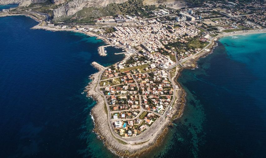 Aerial view of sea by city