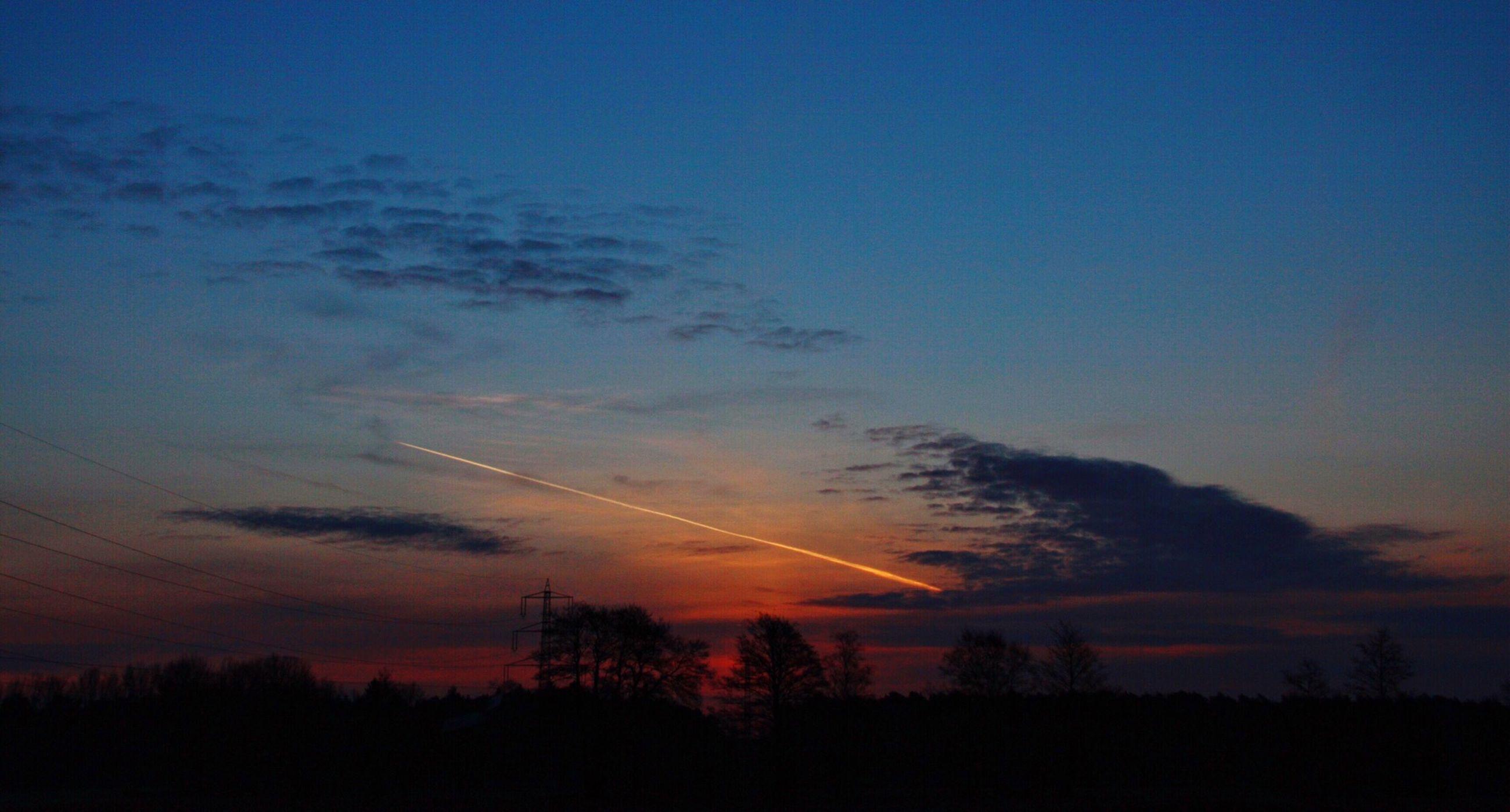 sunset, silhouette, scenics, tranquility, tranquil scene, beauty in nature, tree, sky, nature, landscape, idyllic, orange color, cloud - sky, dusk, blue, outdoors, vapor trail, copy space, no people, majestic